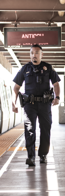 police officer waling outdoors on patrol