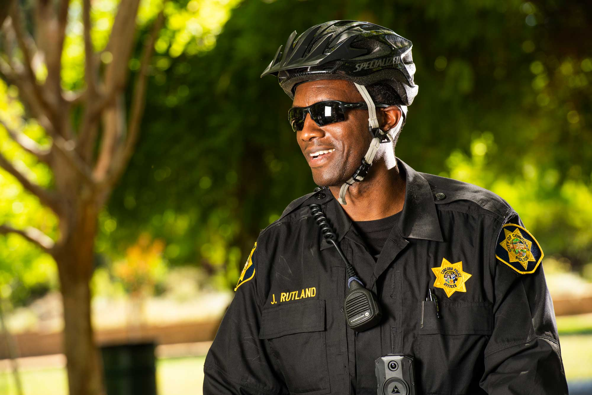 Uniformed police officer outside wearing sunglasses and helmet